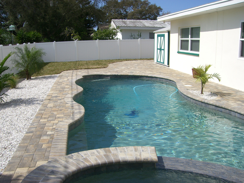 New swimming pools tropical pools and pavers for Unused swimming pool