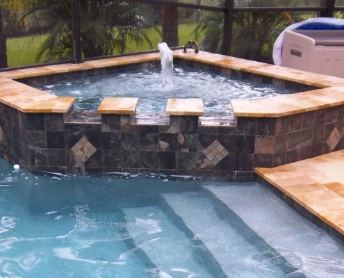 New spa construction tropical pools and pavers for Pool and spa contractors
