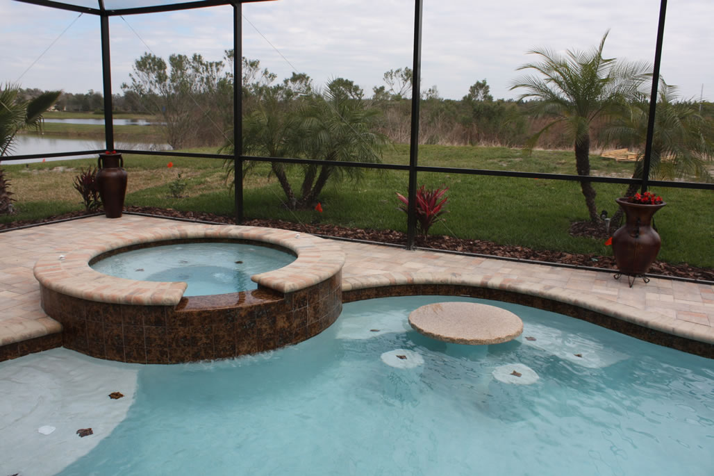 Waterfalls custom options tropical pools and pavers for Swimming pool waterfalls construction